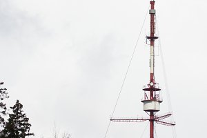 Telecommunication tower Antenna in cloudy sky