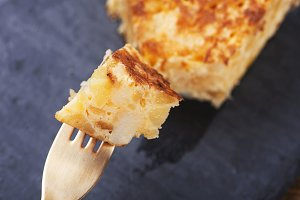Fork with potato omelet. Traditional Spanish food.