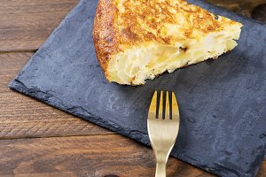 Fork along with potato omelet. Traditional Spanish food.