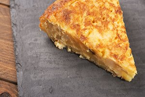 Potato omelette on slate plate. Spanish typical food.