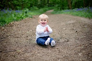 Happy baby clapping outdoors