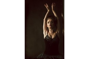 Portrait of the ballerina in ballet tatu on black background