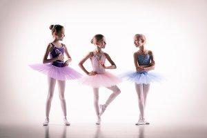 Three little ballerinas in dance studio