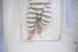 Baby legs in crib