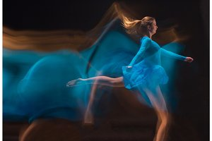 The art photo-emotional dance of beautiful blue woman