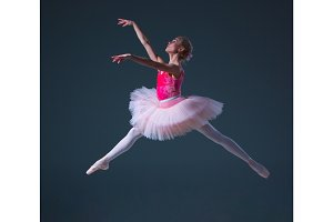 The jump of beautiful female ballet dancer
