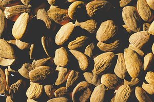 Almonds dried fruit, faded vintage look