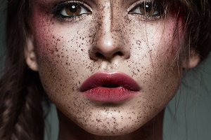 Beautiful strange girl with creative art make-up. Beauty face.