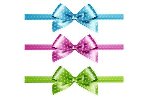 Set of isolated pink, green and blue photorealistic silk polka dots bows