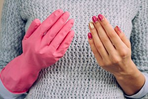 Hand in rubber glove for cleaning