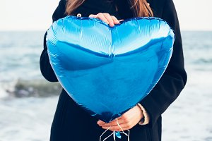 Blue balloon in the shape of a heart