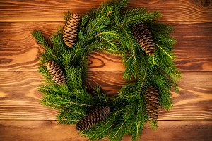 Wreath on the wooden board. Christmas and New year concept