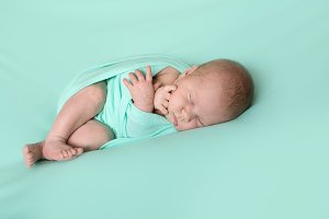 Sleeping cute newborn baby, mint