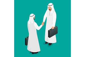 Two arab businessmen in national white garments shaking hands