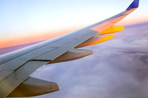 Wing of an airplane at dawn