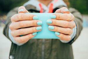 Female hands holding a mobile phone