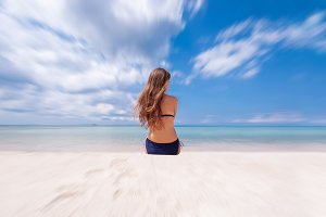 Woman in bikini, enjoy seascape on tropical beach