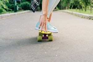 Girl rides on a skateboard