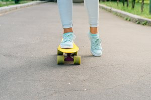 Female riding a skateboard