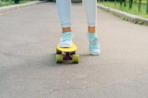 Female riding a skateboard