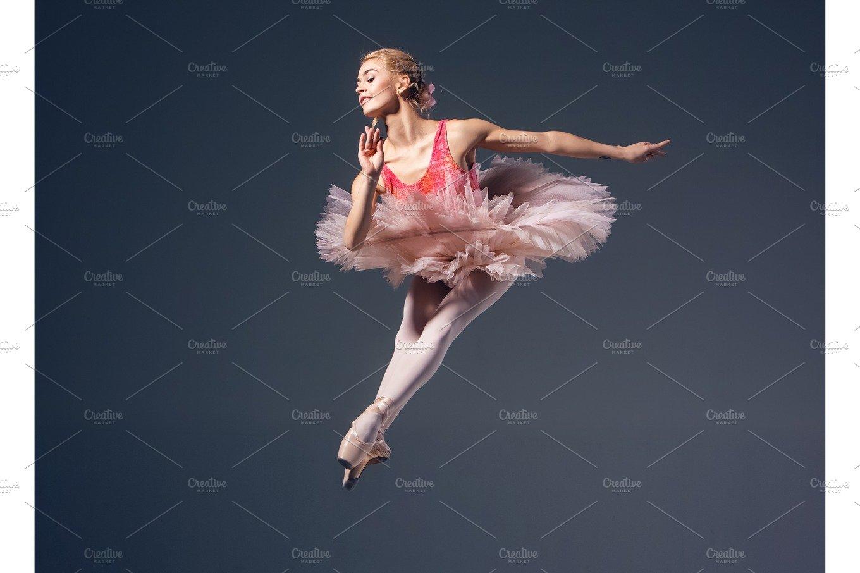 Beautiful Female Ballet Dancer On A Grey Background Ballerina Is