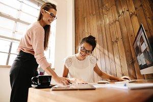 Smiling creative business women