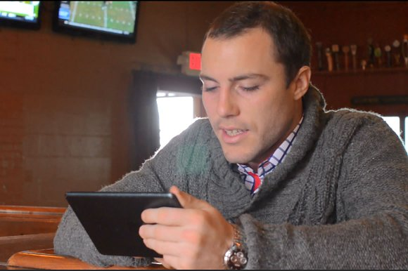 video of young man using a tablet