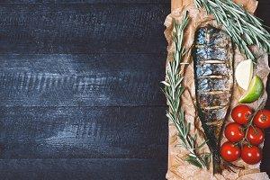 Fish with rosemary, lemon, tomato