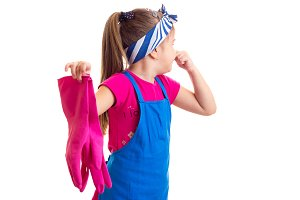 Girl in apron and gloves