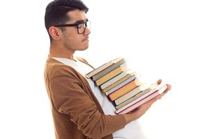 Young man in glasses with books
