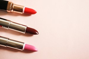 Lipsticks on a beige background