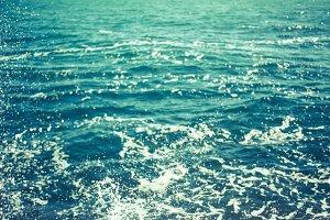 Marine background - blue water with foam spray