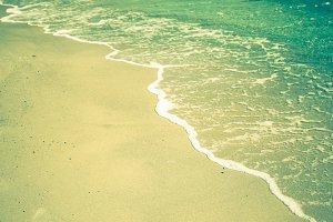 Edge of sea waves on a sandy beach