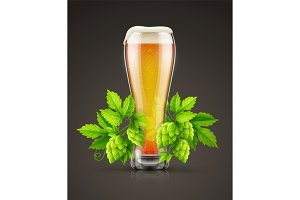 Glass of light lager beer with hop plant