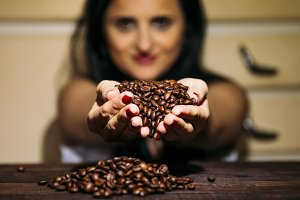 Girl with coffee beans