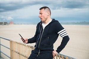 athlete man using mobile phone