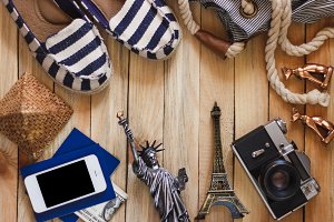 Slippers, camera, phone, miniature of the statue of liberty and Eiffel Tower
