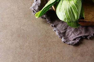 Overhead shot of Chinese cabbage, Bok Choy, on rustic background