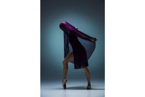 The beautiful ballerina dancing with blue veil