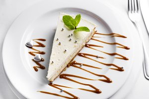 Cheesecake with mint leaves