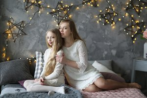 Beautiful blond mom and daughter