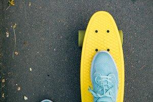 Yellow skateboard with green wheels
