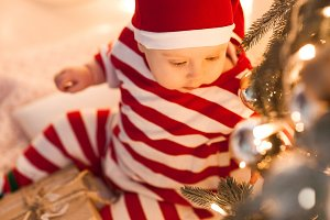 Baby under Christmas tree