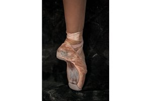 The close-up  foot of young ballerina in  old pointe shoes