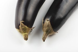 Close-up of two aubergines on white background. Isolated.