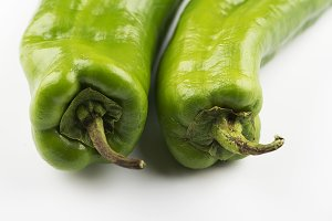 Close-up raw green peppers on white background. Appetizing green peppers.