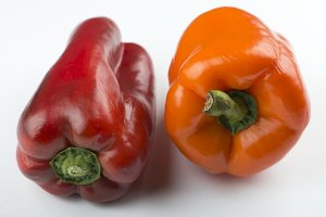 Red and orange peppers on white background. Isolated.