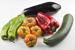 Appetizing tomatoes, red pepper, aubergine and gherkin on white background. Isolated. Healthy food.