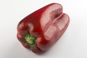 Red pepper on white background. Horizontal shoot.