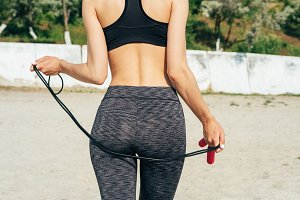 Slim girl in sportswear